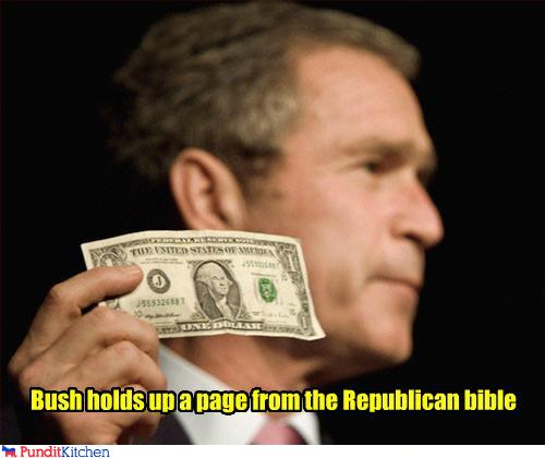 political pictures - Bush holds up a page from the Republican bible
