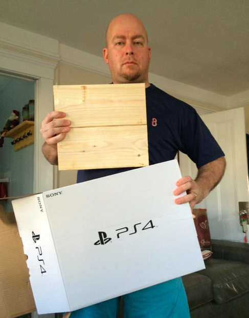 little boy receives block of wood instead of ps4